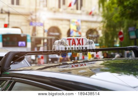 Close-up of taxi sign in Paris, France