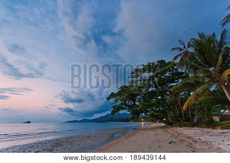 Tropical beach in ebb time after sunset