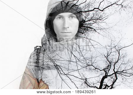 Double exposure effect photography. Hiker in the wild forest.
