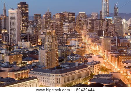 Aerial View of San Francisco Downtown and Market Street at Dusk. Seen from an elevated point in Van Ness - Civic Center neighborhood in San Francisco, California, USA.