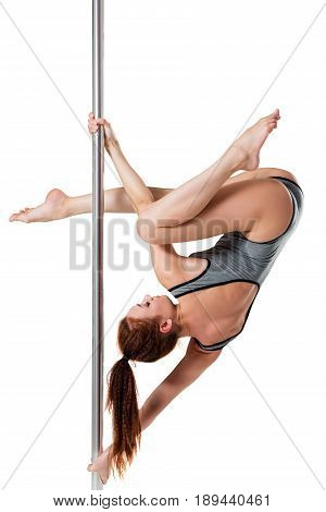 Strong And Beautiful Girl Posing On A Pylon On A White Background