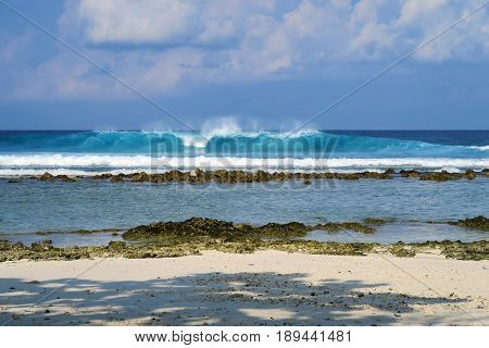 Blue ocean wave on beach of Maldives island Himmafushi, Jailbreaks spot