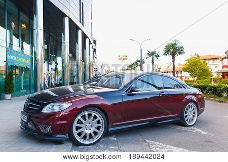 Nessebar Bulgaria - September 02 2016: A red and black luxury car parked outside a hotel.