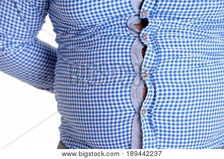 Adult man in small shirt on white background. Weight loss concept