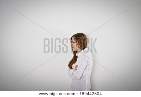 Sad and Unhappy woman in white is crying.