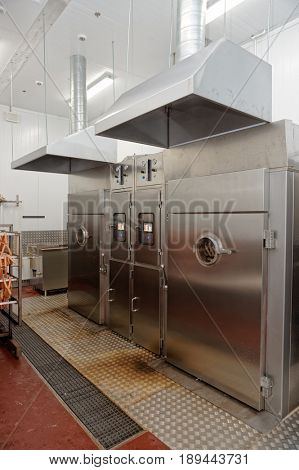 Meat and fish smoking chambers on food processing plant