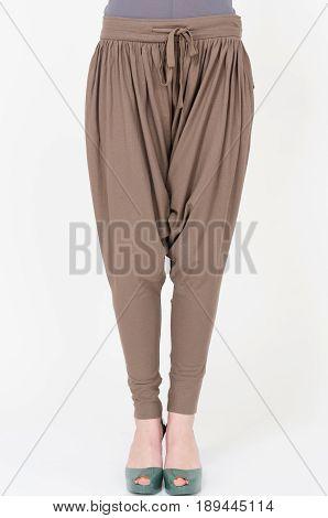 Young woman wearing fashion pants closeup shot