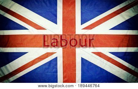 Close up of a British flag with Labour text and texture and vignette.