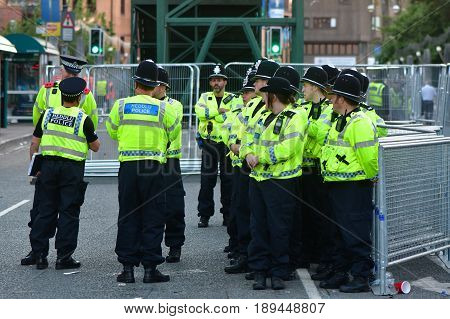 CARDIFF UK - 3 JUNE 2017 Large group of police during Champions League Final. British police and security services on high alert as hundreds of thousands of fans enjoy football in the capital of Wales