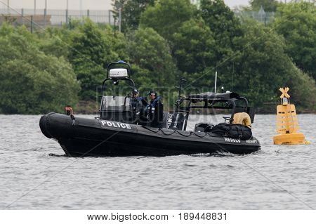 CARDIFF, UK - JUNE 02 2017 Police boat patrols Cardiff Bay before Champions League final. Security is high as Wales prepares to host the final of the European football at Principality Stadium