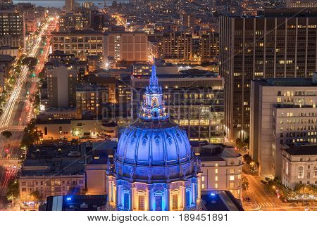 Aerial View of San Francisco City Hall at Night with Golden State Warriors Colors. Civic Center, San Francisco, California, USA.