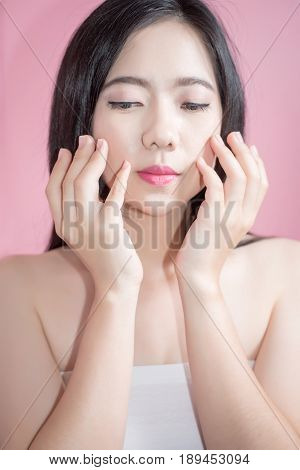 Long Hair Asian Young Beautiful Woman Point Finger Upward Isolated Over Pink Background. Natural Mak