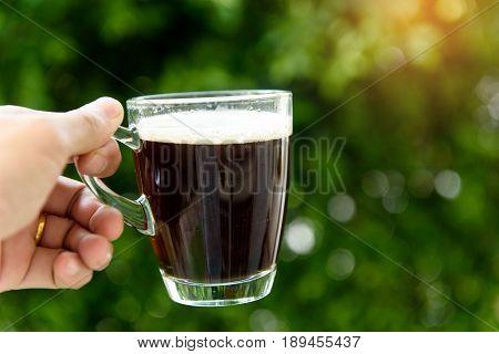 Hand Holding Coffee