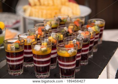 Delicious multi - layered fruit jelly made from wild strawberries blueberries and slice of fruit