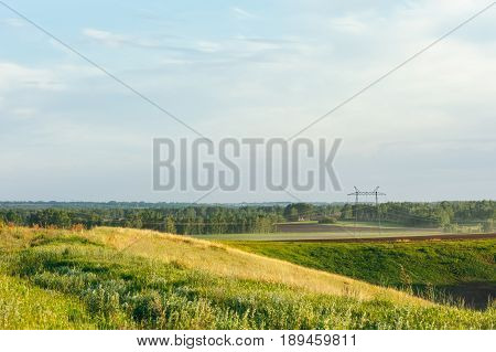 Picturesque fields of Altai. Wires of electric voltage.