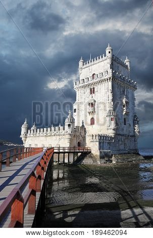 Belem Tower against a dramatic sky. Lisbon Portugal