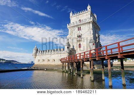 Belem Tower on the background of blue sky. Lisbon Portugal
