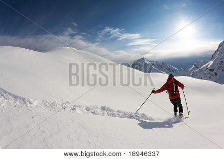 Freerider skier moving down in snow powder; italian alps.