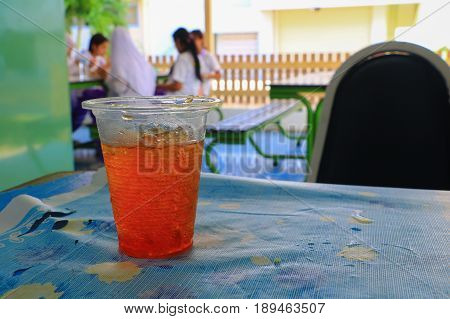glass of ice tea drink are on a table in public park restaurant