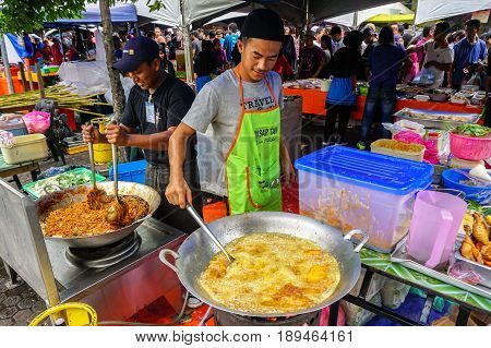 Kota Kinabalu,Sabah-May 28,2017:Street local foods prepare and sell food on the street in Kota Kinabalu,Sabah,Malaysia.Kota Kinabalu is one of the most vibrant and popular food capitals in the Borneo.