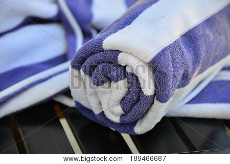 Close-up Of Rolled Up Blue Bath Towel