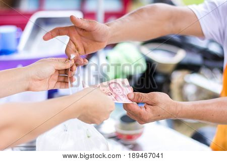 Customer Paying Bill By Cash At Open Air Market