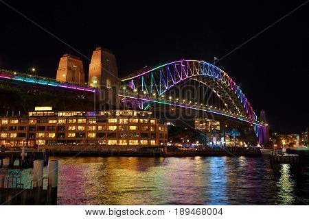 SYDNEY AUSTRALIA - MAY 29 2017; Sydney Harbour Bridge lit up in rainbow of colours for Vivid Sydney festival