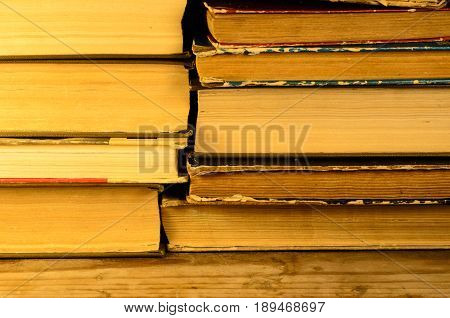 Pile Of The Books On Wooden Table