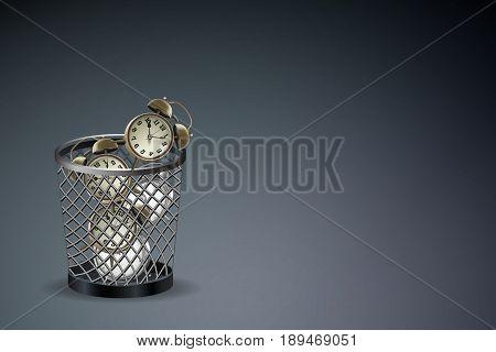 Waste of time concept : Alarm clock in trash bin. (3D Illustration)
