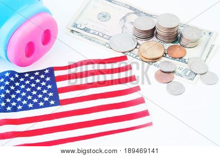 USA flag stack of coins and dollors Travel America concept