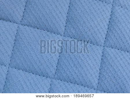 Background Pattern Closed up of Abstract Texture of Blue Fabric Sofa or Upholstery.