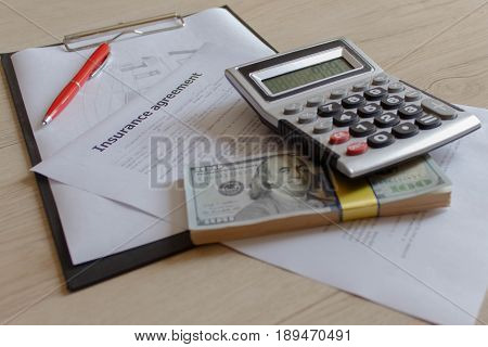 Renters insurance policy. Car insurance form with pen and calculator on the table. Insurance concept