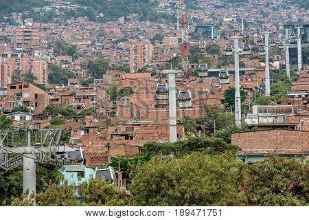 Medellin,  Colombia- March 5, 2017: Cable cars travel over Medellin slums in Guatape,Colombia