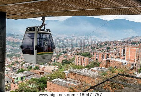 Medellin, Colombia- March 5, 2017: Cable cars travel over Medellin slums Colombia