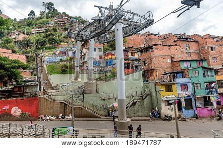 Guatape, Colombia- March 5, 2017: Cable cars travel over Medellin slums Colombia