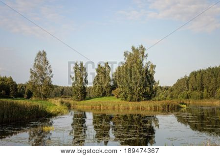 Country landscape with pond in Petrovskoe village Museum-reserve of A.S. Pushkin Pskov region Russia