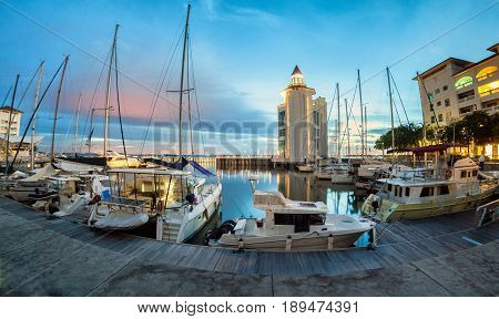 Straits Quay Lighthouse view during sunrise with yachts and boats as foreground