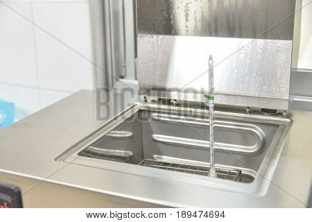 Water bath  lab equipment in lab with thermometor