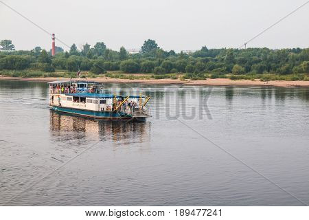 Boat On The River And The People In A Summer Evening