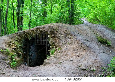 Entrance to an old abandoned dungeon. Ancient homestead Gorenki in the Moscow region.