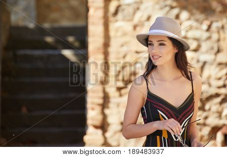 attractive woman tourist  with hat in old european town