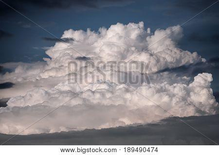 Dangerous cumulonimbus cloudscape as beautiful background at sunset.