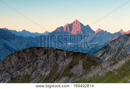 sunrise light on mountain tops in Alps