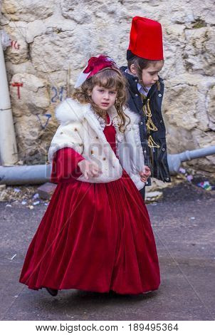 JERUSALEM - MARCH 13 : Ultra Orthodox children during Purim in Mea Shearim Jerusalem on March 13 2017 Purim is a Jewish holiday celebrates the salvation of the jews from genocide in ancient Persia