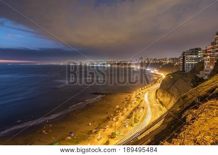 The Pacific coast of Miraflores at night in Lima Peru