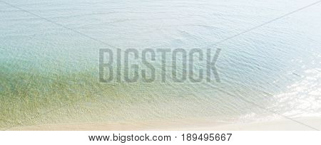 Clear seawater at the beach in summer - panoramic web banner
