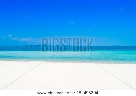 Baeutiful white sand beach with clear blue seawater in summer