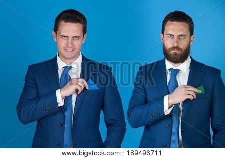 Businessman Putting Different Business Cards In Pockets