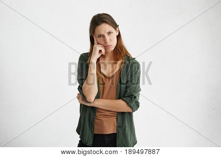 Horizontal Shot Of Unhappy And Upset Young Female Employee Or Customer Having Thoughtful Pensive Exp