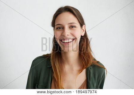 Lovely Young Woman With Long Silky Hair And Luminous Dark Eyes Having Perfect Teeth Smiling With Ple